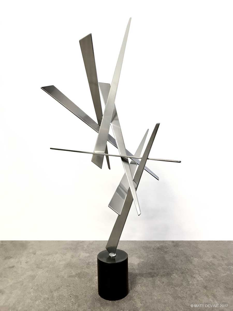 EDWARD #16, 2017, steel with chrome powdercoat, patina base, 36H x 12W x 10D