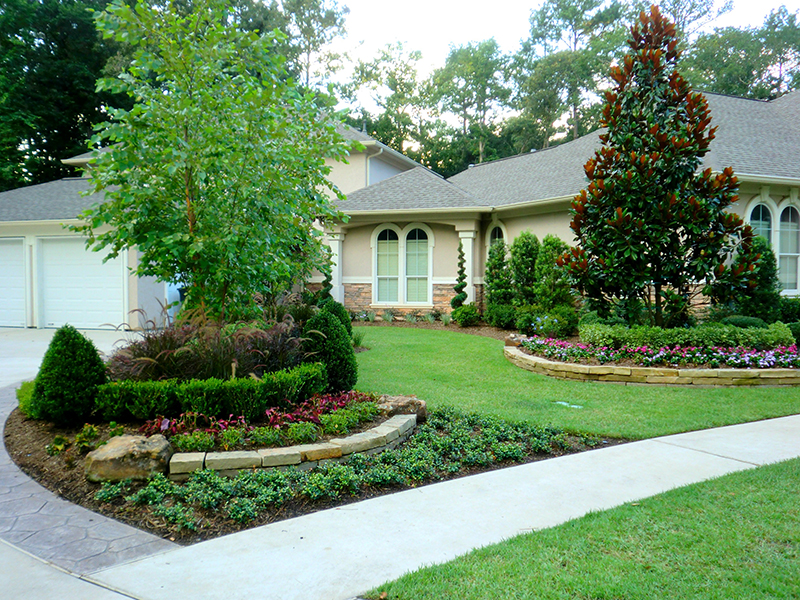 aa-landsape-design-installation-stone-moss-rock-border-the-woodlands-best-envy-exteriors-maintenance-houston-tx.jpg