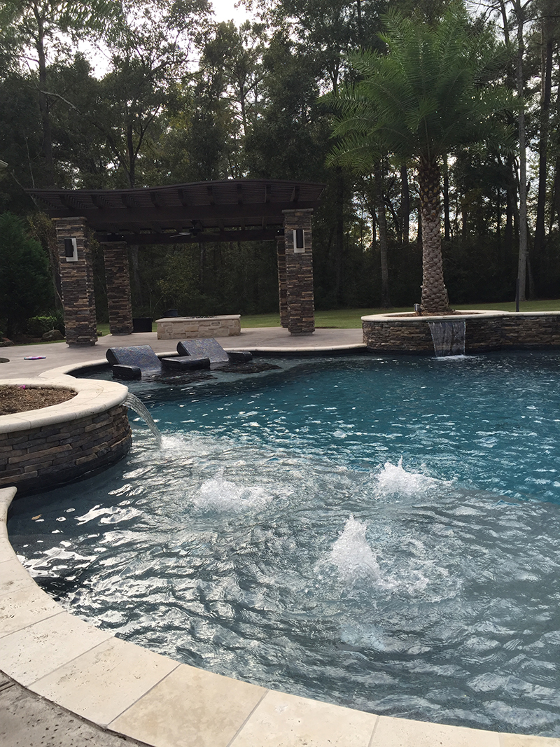 Custom-Pool-stacked-stone-arbor-pergola-limestone-firepit-built-in-lounge-glass-mosaic-tile-the-woodlands-houston-palms-travertine-spring-montgomery-conroe.jpg