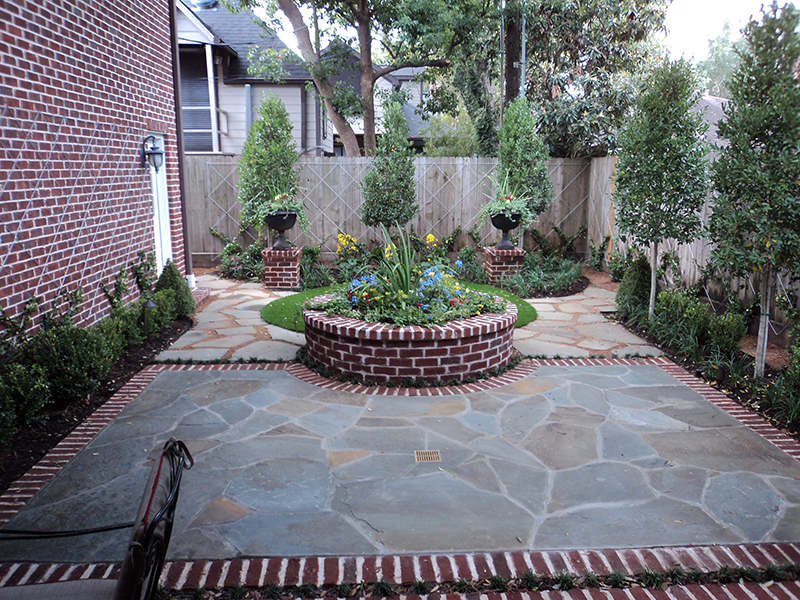 english-landscape-courtyard-boxwood-brick-red-landscaper-landscape-landscaping-ideas-best-company-builder-build-design-designer-hardscape-the-woodlands-cypress-houston-custom-ideas-montgomery-spring-urns-pottery-planter.jpg