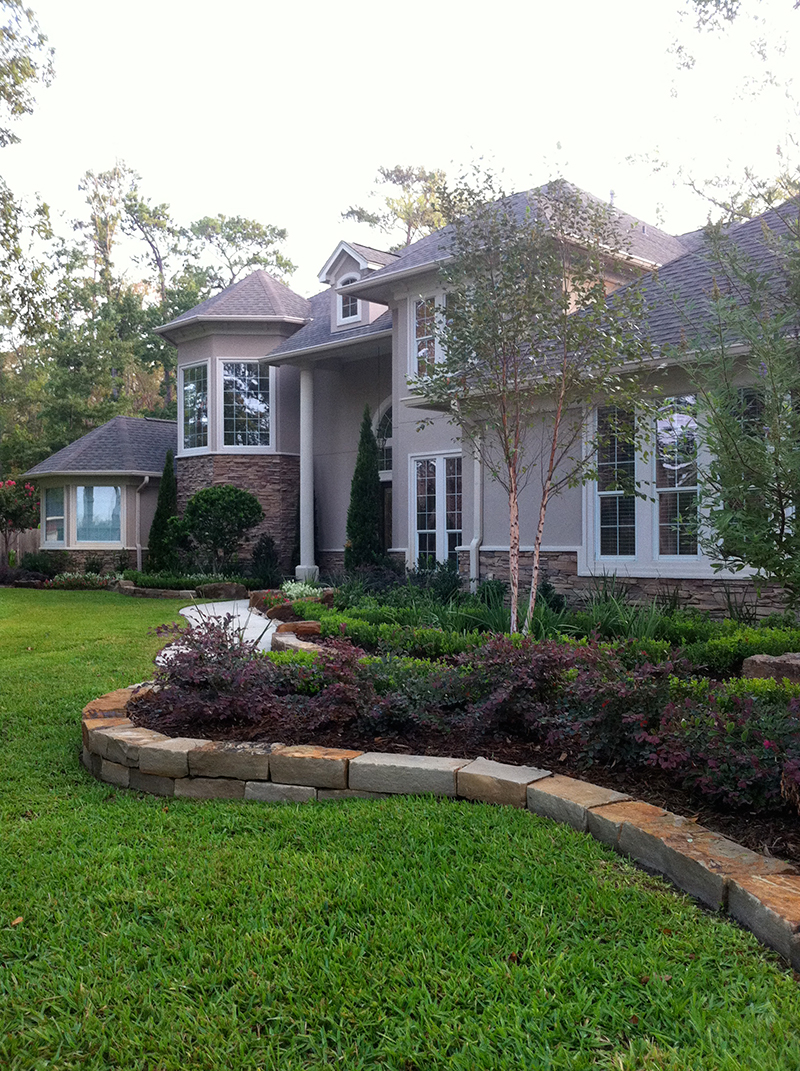 landscape-beds-stone-border-moss-rock-houston-the-woodlands-tx-spring-conroe-new-designer-landscape-pool-builder-build-best-beautiful-retaining-wall-envy-exteriors-lawn-care-lawn-maintenance-service-irrigation.jpg