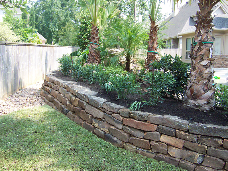 landscaping-around-pool-landscape-moss-rock-retaining-wall-walls-stone-palms-ideas-best-company-the-woodlands-spring-montgomery-woodforest-houston-magnolia-conroe-pool-builder-installation-installer-repair-drainage-sprinklers-lighting-.jpg