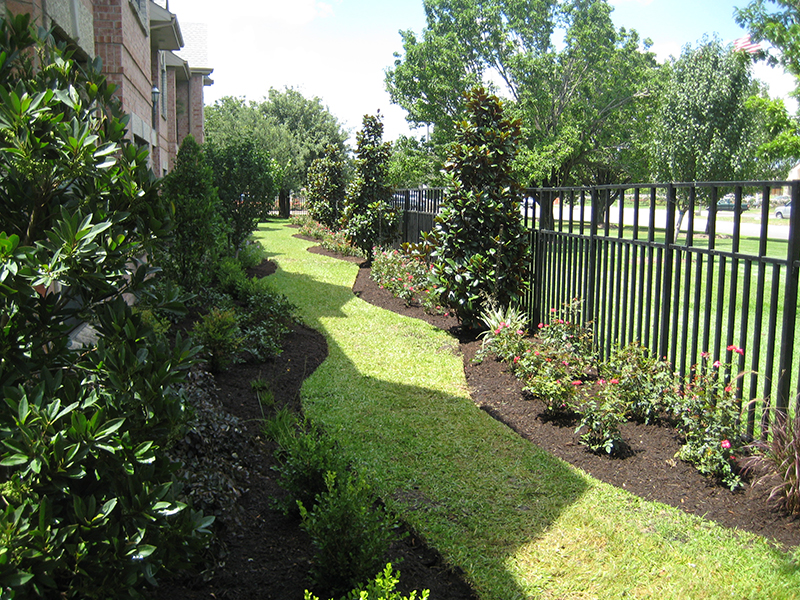 landscaping-landscape-design-wrought-iron-fence-envy-exteriors-design-the-woodlands-houston-spring-tomball.jpg