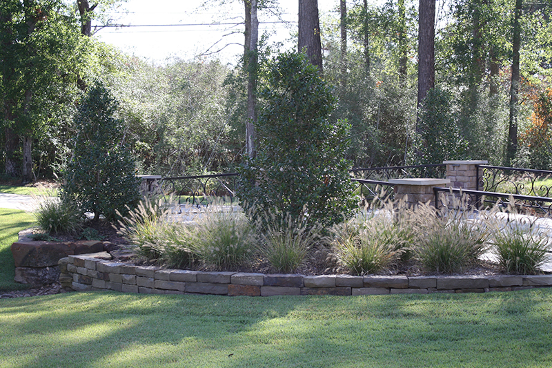 the-woodlands,-tyx-woodlands-spring-conroe-cypress-montgomery-custom-landscape-design-install-landscaper-stone-culvert-bridge-driveway-moss-rock-holly-columns-riverbed-wooded-wrought-iron-commercial-landscaping.jpg