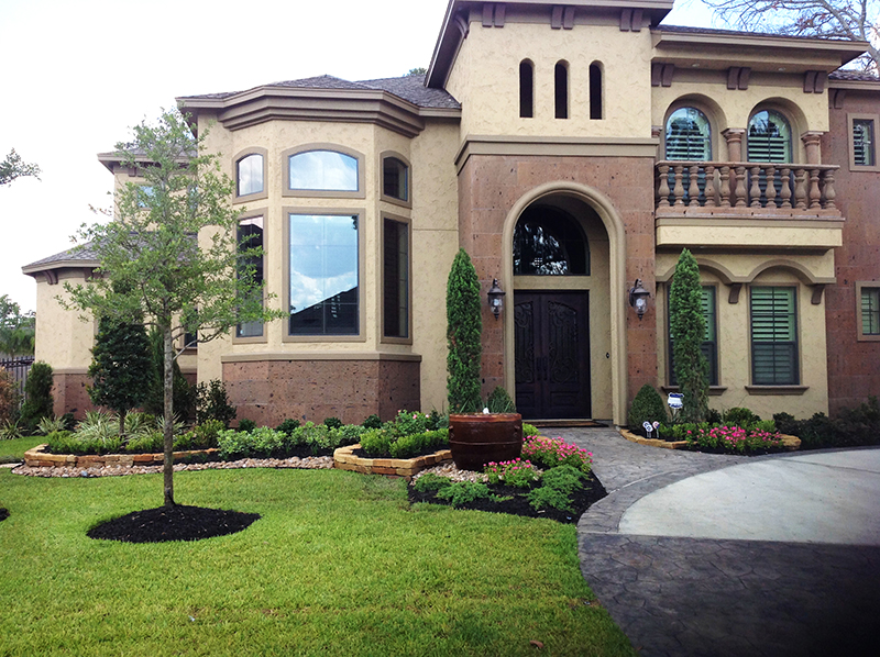 tuscan-style-landscape-water-feature-moss-rock-stone-wall-italian-cypress-bull-rock-border-Spring-landscaper-landscaping-best-the-woodlands-houston-montgomery-magnolia-installation-installers-company-maintenance-lawn.jpg