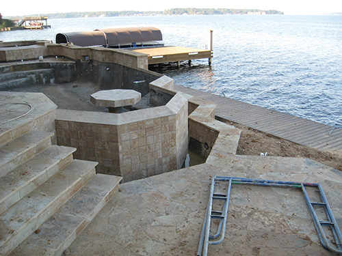 custom-pool-lake-conroe-conroe-on-lake-infinity-zero-edge-design-build-pool-builder-stone-table-in-pool-designer-architect-luxury-top-best-award-wining-the-woodlands-houston-spring-magnolia-conroe-montgomery-cypress.jpg