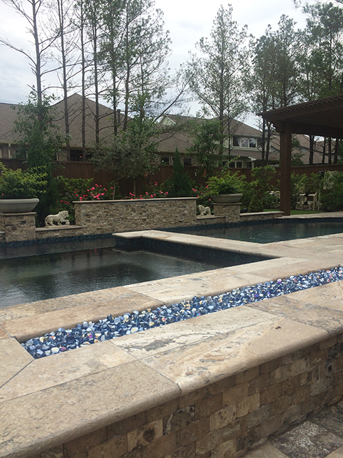 new-pool-construction-pool-builder-the-woodlands-tx-houston-custom-design-build-travertine-pebble-tec-pebble-sheen-landscape-fire-feature-best-aggie-owned-spring-montgomery-cypress-magnolia.jpg
