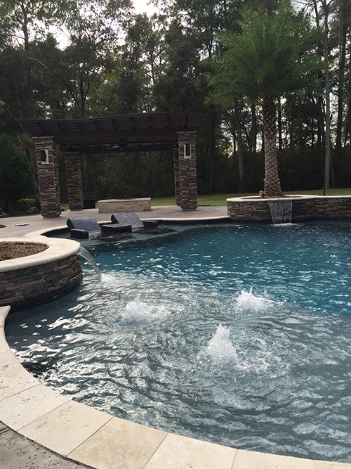 outdoor-arbor-pergola-stone-espressocedar-wood-stained-firepit-hill-country-the-woodlands-landscaper-landscape-company-houston-best-pool-lighting-palm-spring-conroe.jpg