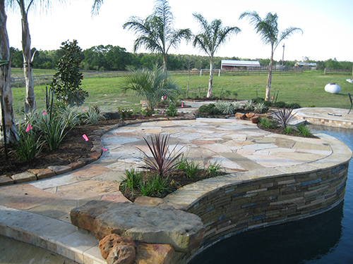 pool-custom-sitting-area-pool-builder-construction-landscape-flagstone-stone-best-pools-designer-landscaper-designs-builds-the-woodlands-houston-spring-magnolia-conroe-montgomery-cypress.jpg