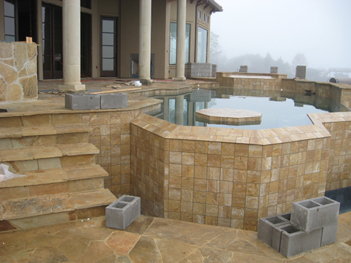 pool-design-construction-beautiful-zero-edge-infinity-lake-view-slope-water-pebble-tec-pool-builder-installation-patio-stairway-best-builder-company-envy-exteriors-the-woodlands-houston-spring-magnolia-conroe-montgomery-cypress-aggie.jpg