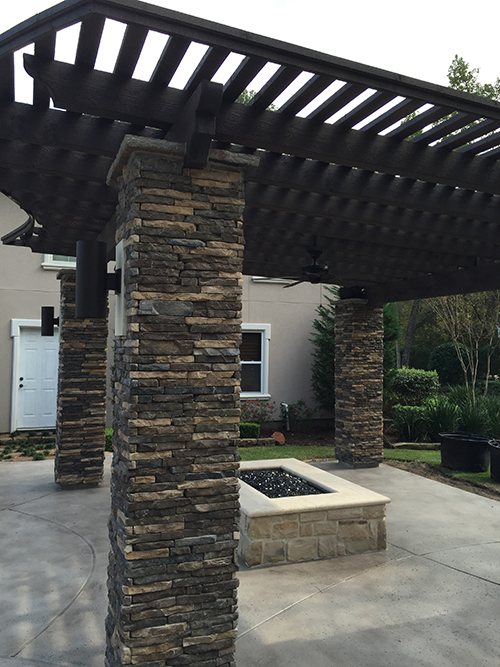 stone-stone-columns-dry-stacked-stacked-cultured-coronado-pool-arbor-limestone-hill-country-houston-the-woodlands-builder-envy-best-aggie-pergola-custom-design-landscape-spring-cypress-montgomery.jpg