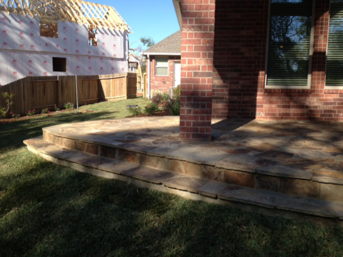 Custom-Stone-Installation-flagstone-the-woodlands-spring-magnolia-landscape-construction-envy-exterior-patio-under-cover-stairs-landscaping-landscaper-best-top-installers-deck-patios-custom.jpg