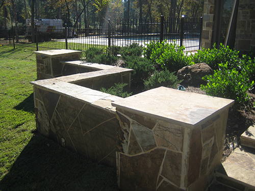 Custom-Stone-Installation-stone-seating-wall-flagstone-landscape-pool-the-woodlands-houston-tx-houston.jpg