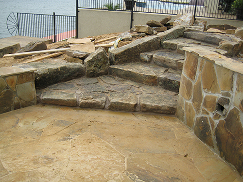 Custom-Stone-walkway-stairs-retaining-wall-conroe-on-the-lake-magnolia-the-woodlands-landscape-pool-pool-builder-new-home-construction-landscaper-installer-custom-design-montgomery-houston-pool-hardscape-flagstone.jpg