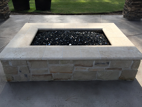 firepit--fire-pits-custom-limestone-glass-gas-best-landscaper-the-woodlands-design-and-build-general-construction-houston-luxury-pool-builder-and-landscape-spring-montgomery-aggie.jpg
