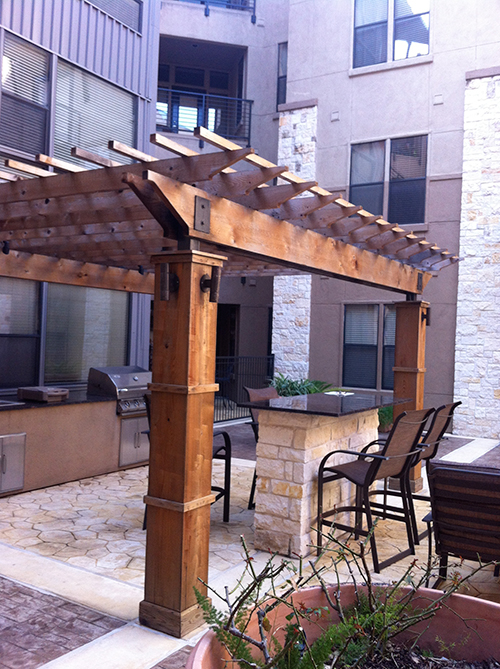 outdoor-kitchen-pergola-arbor-stone-design-build-construction-cedar-the-woodlands-spring-magnolia-cypress-envy.jpg
