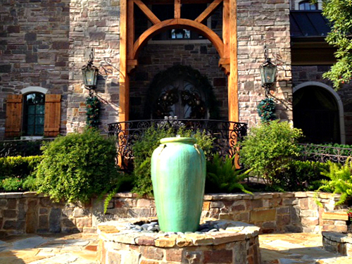 outdoor-seating-area-stone-brick-flagstone-water-fountain-feature-custom-design-installation-urn-pottery-with-fountain-carlton-woods-the-woodlands-spring-houston-luxury-builder-landscaper-cypress-conroe-montgomery.jpg