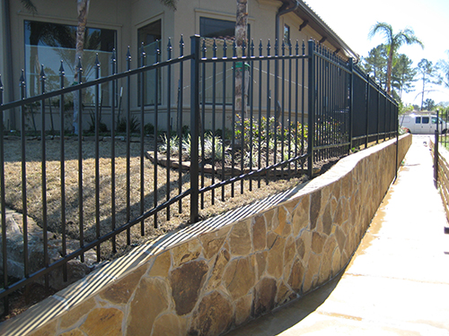 retaining-walls-lake-wrought-iron-fencing-landscape-landscaper-landscaping-ideas-aggie-top-luxury-custom-pool-builder-walkway-new-home-residential-commercial-the-woodlands-houston-spring-magnolia-conroe-montgomery-cypress.jpg
