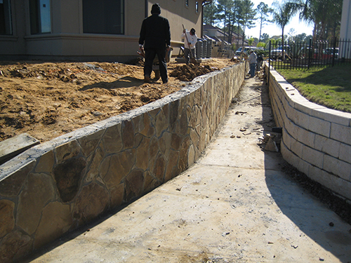 stone-flagstone-retaining-wall-lake-conroe-walls-walkway-to-lake-landscaper-landscaping-drainage-best-company-construction-new-builder-pool-the-woodlands-houston-spring-magnolia-conroe-montgomery-cypress.jpg