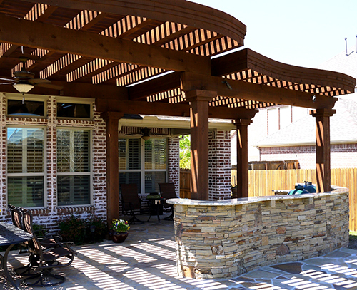 wood-pergola-arbor-covered-outdoor-kitchen-built-in0green-egg-new-home-flagstone-brick-limestone-by-pool-builder-best-installation-installer-landscaping-landscaper-the-woodlands-spring-montgomery-houston-conroe-cypress.jpg