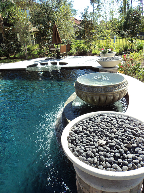 cast-stone-fire-firebowls-urn-lava-rock-pool-pools-ideas-accents-custom-design-build-builder-the-woodlands-tx-houston-montgomery-cypress-spring-woodforest-gas-gas-ring-custom-luxury.jpg
