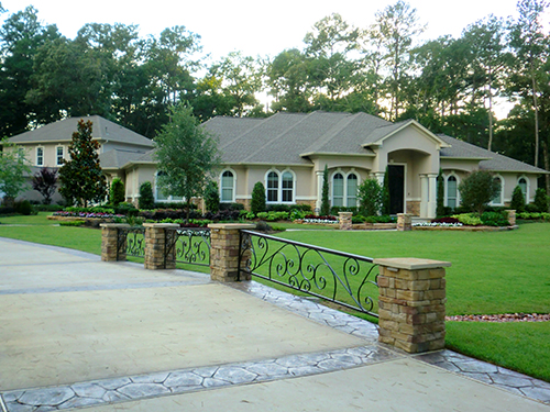 custom-landscape-design-stone-zoysia-envy-installation-the-woodlands-magnolia-houston-wrought-iron-bridge-scroll.jpg