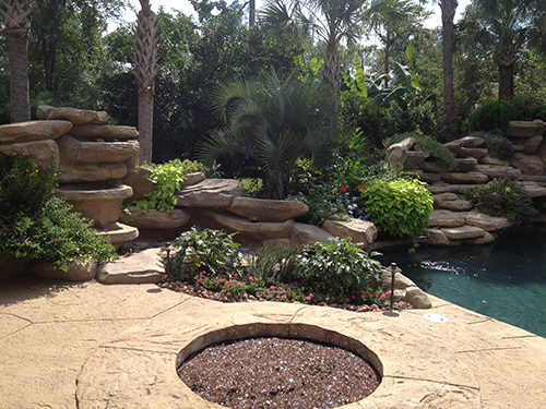 glass-firepit-fire-feature-pool-waterfall-stone-custom-envy-the-woodlands-carlton-woods-envy-landsacpe-design.jpg