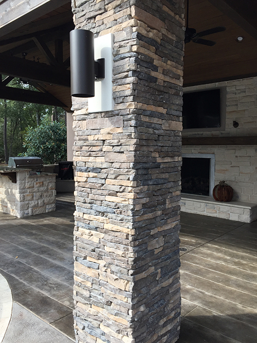 outdoor-kitchen-stone-columns-dry-stack-coronado-cultured-limestone-hill-country-wood-stamped-concrete-cedar-the-woodlands-tx-houston-spring-cypress-conroe-memorial-best-pool-landscape.jpg