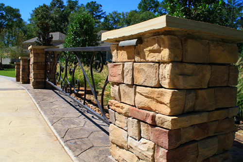 stone-column-stamped-concrete-driveway-bridge-installation-design-envy-the-woodlands.jpg