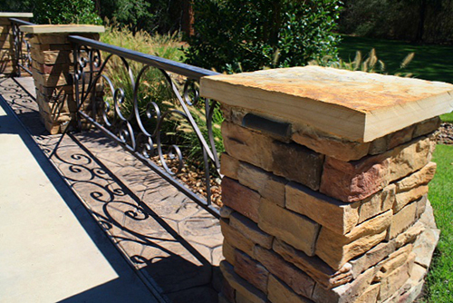 stone-columns-coranado-caramel-mountain-manufactured-stone-with-wrought-iron-scroll-flagstone-cap-the-woodlands-envy-spring.jpg