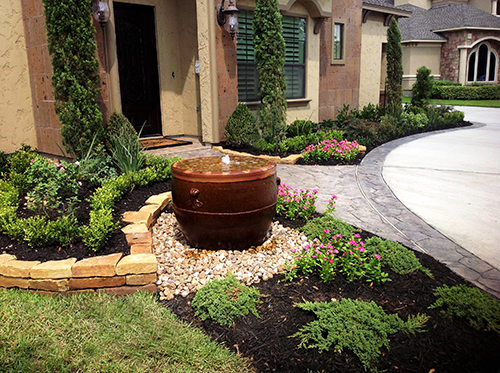urn-pot-pots-pottery-landsacpe-within-landscape-landscaper-design-custom-build-builder-construction-company-fountain-water-inside-urn-planter-the-woodlands-spring-magnolia-montgomery-cypress-conrow-houston-best-top-landscaping-designer.jpg