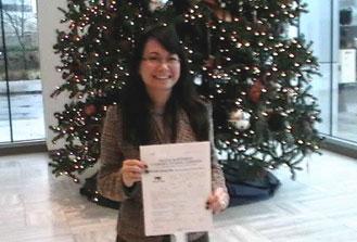 Deb-B Kamisato, VA Regional Office CFC Coordinator,happily submits their CFC pledges.