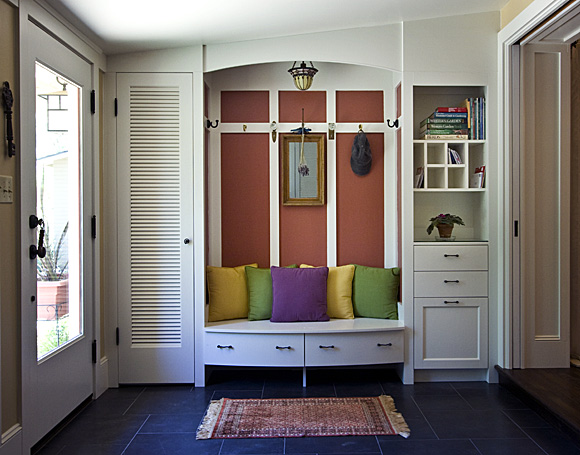Don't need a mudroom? Think again! Kick off shoes under the bench, pitch trash in a hidden bin, and use mail slots to control clutter. Hang up your jacket . . . Welcome home!