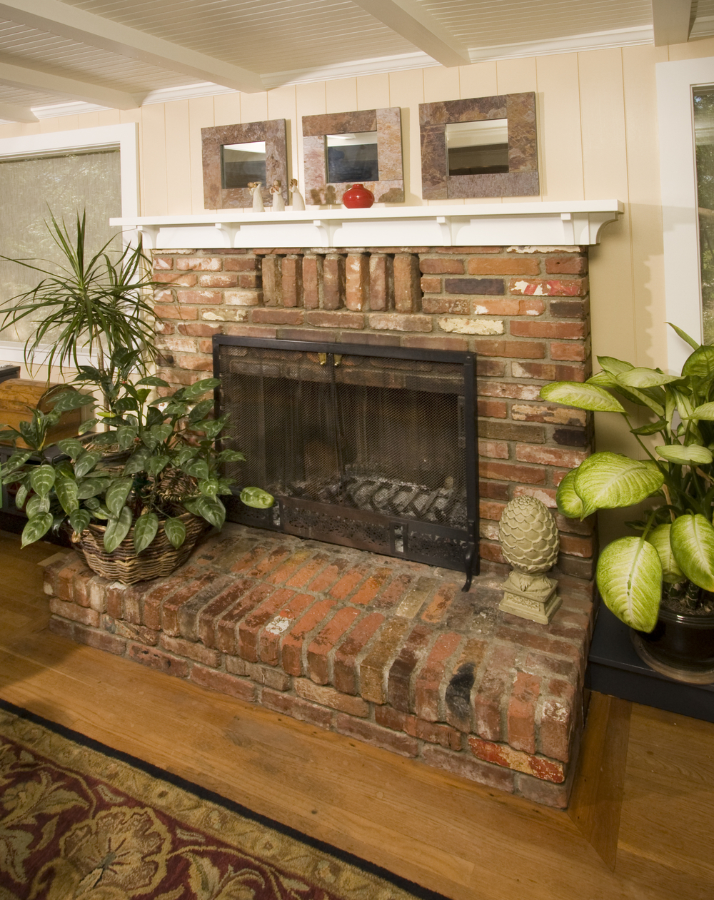 A simple mantel echos the clean lines found elsewhere in this Yucaipa Craftsman.