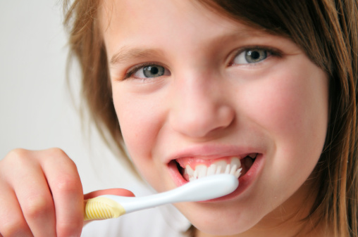 Child brushing teeth dental hygiene