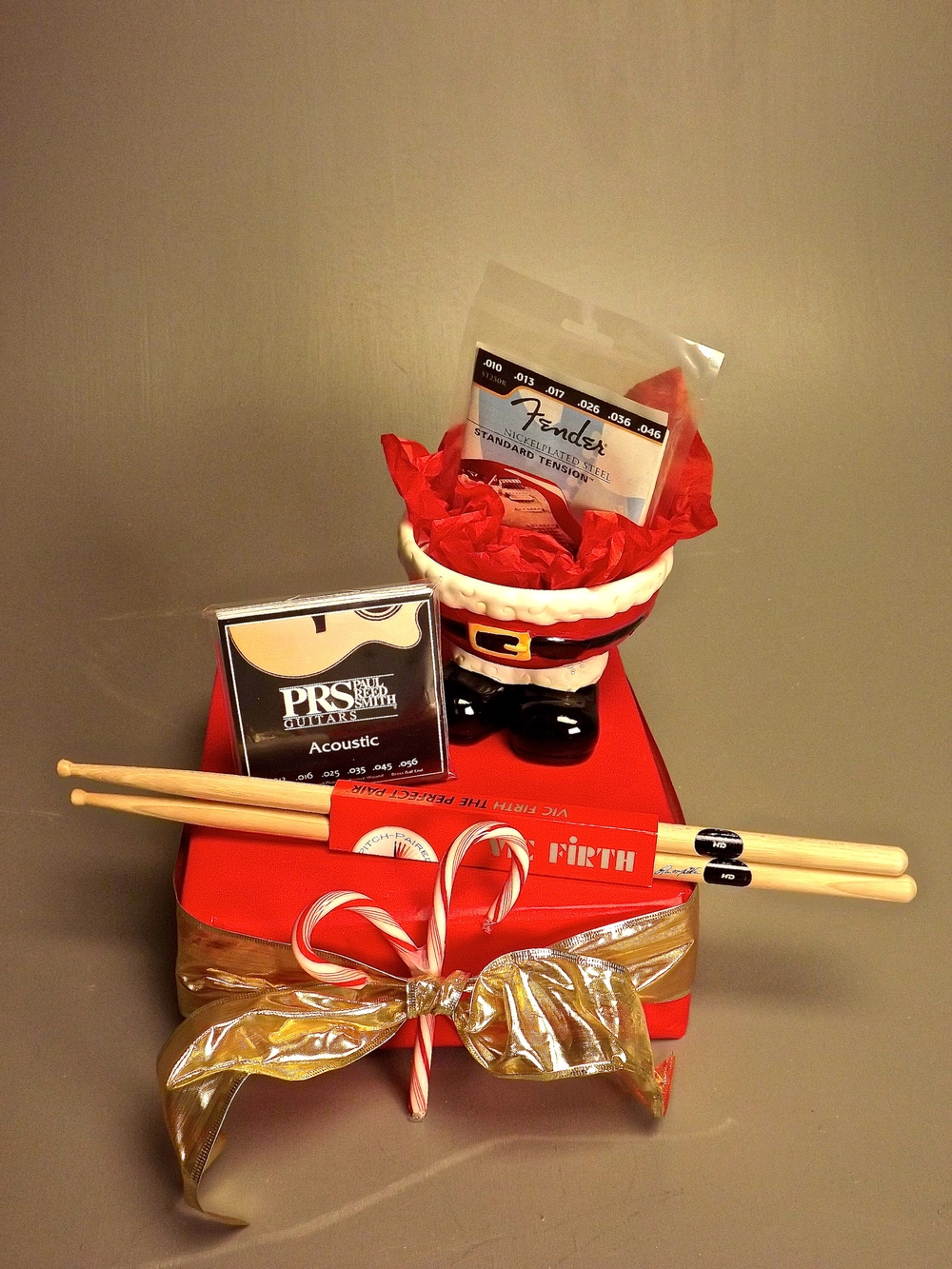 One set of drumsticks, One package acoustic guitar string, One package electric guitar strings.