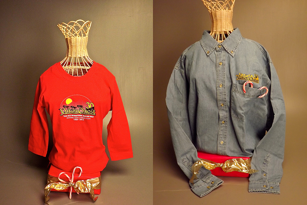 Two Yukon Quest shirts: Denim size large, Red Women's size small
