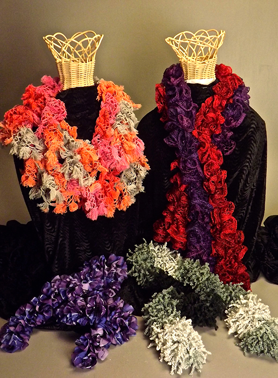 Five hand-knitted scarves.