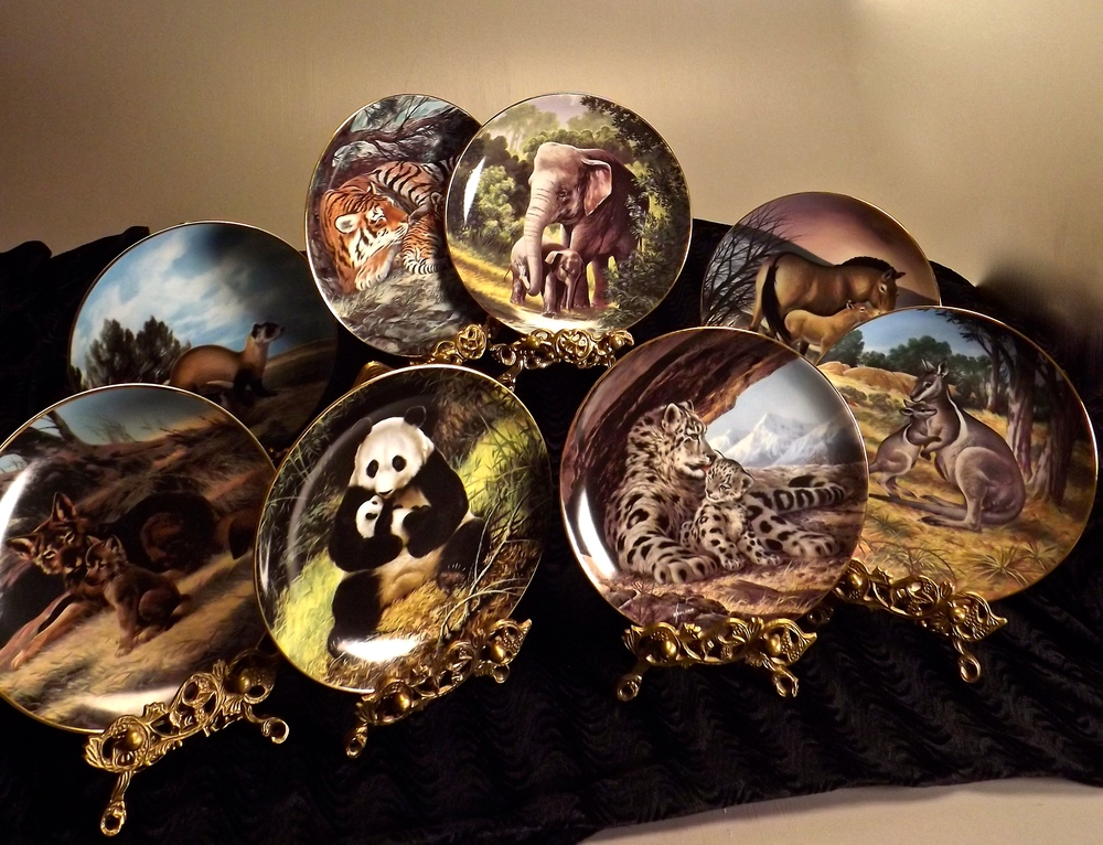 "Set of 8 ""Last of Their Kind: The Endangered Species"" collector plates by W. S. George"
