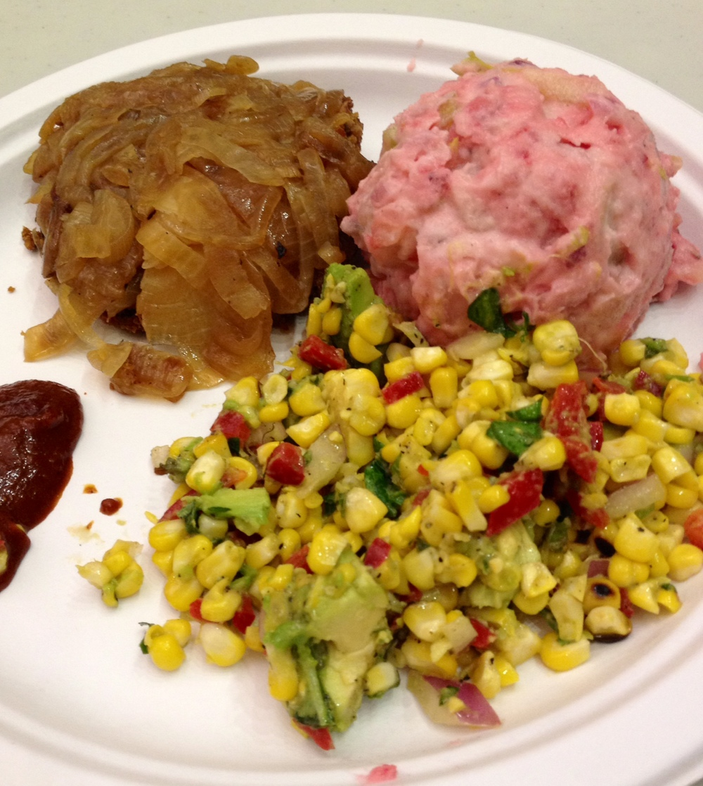 Finished dinner! This picture doesn't do it justice, it was delicious! Bean Burger with caramelized onions, Roasted Corn Salad, Beet Potato Salad, and homemade ketchup.