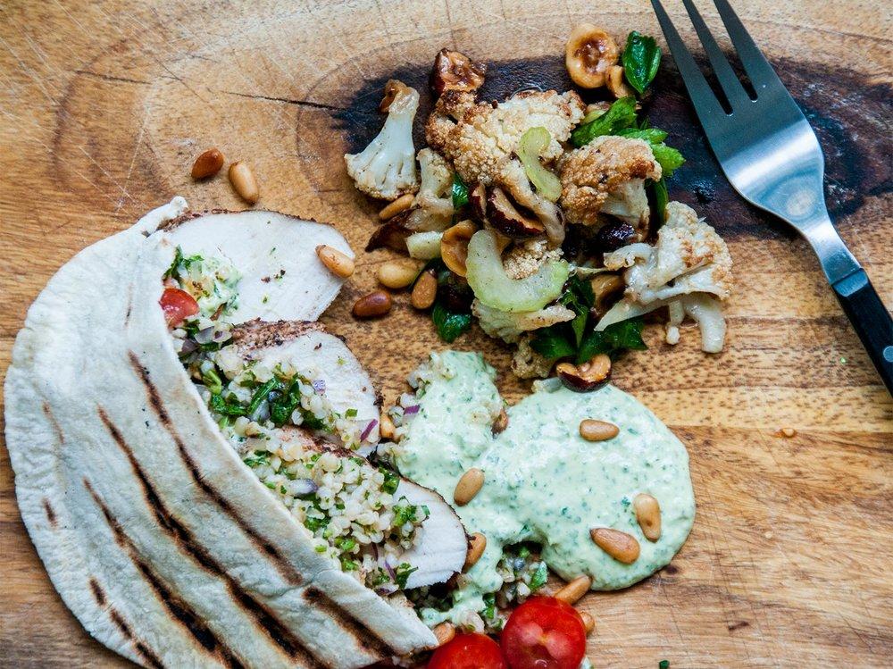 za'tar chicken flatbreads, with parsley & tahini sauce & a hazelnut & cauliflower salad