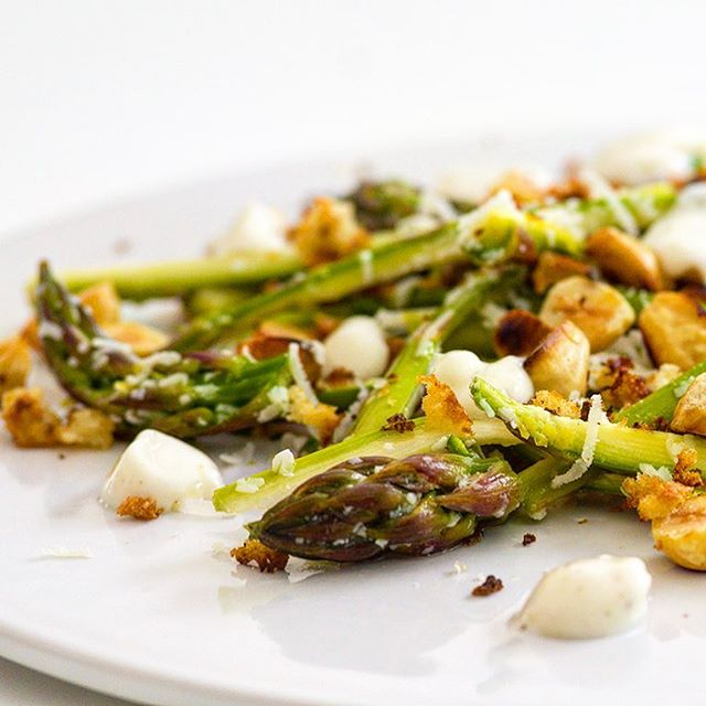 """15 Minute Asparagus Salad with Roasted hazelnuts and breadcrumbs  Asparagus is drawing near the end of it's season (end of April to the end of June) so I'm trying to squeeze in my favourite asparagus salad before it's too late! Fresh, green, tender asparagus mixed with Parmesan for a touch of saltiness and depth, toasted hazelnuts and breadcrumbs for texture and a creamy, soft lemon & yogurt dressing. Delicious.  It's a super easy recipe - the only cooking involved is toasting the hazelnuts and breadcrumbs. The lemon juice """"cooks"""" the finely sliced asparagus stems so no chance of you over-cooking the asparagus, like I have done many, many times.  The dressing is a simple yogurt/lemon juice/seasoning mix, but you can add other flavours in there too if you fancy it - sumac, garlic, chilli - but I like to keep it straightforward and clean with the asparagus flavour shining through.  I also like to enhance the lemon side of the flavours by using  a lemon infused rapeseed oil, from the very local producer Broighter Gold, to toast the breadcrumbs. It's subtle but I miss it when I don't use it.  Last of all... I'm sure you are aware of the after-effects of asparagus but if you're not then check out this link  . It was a great way to get my kids to try asparagus for the first time :) #asparagussalad #simplesalads #roastedhazelnuts #breadcrumbs #15minutes #eathealthy #homemade #bringbackthesunshine #shakirawriteaboutlove #shakiranelis . . . . . #irishfoodie #irishfoodblogger #northernirelandphotographer #northernireland #nifood #nifoodblogger #derry #derryfoodblogger #madeinderry #theartofslowliving #livethelittlethings #livethelifeyoulove #creativepreneur #creativeproject"""