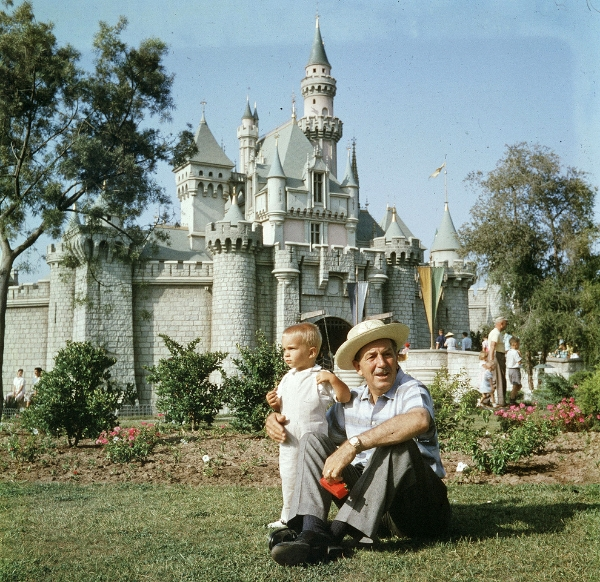 Walt and his grandson taking a break by the castle // Image © Disney