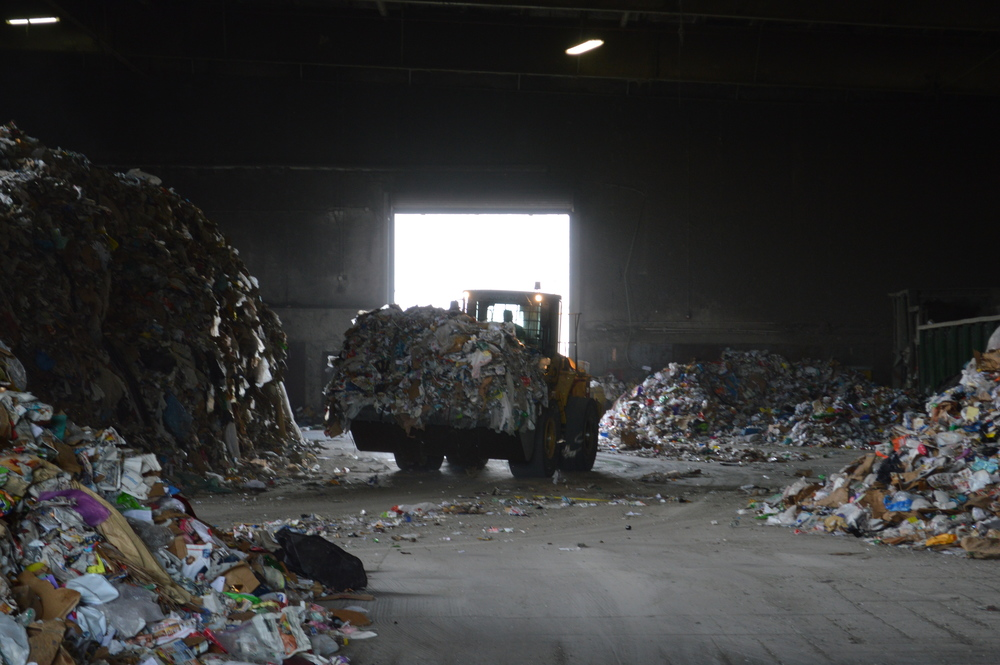 Waste Management works quickly to sort the 40-50 tons of material brought to the facility each hour.