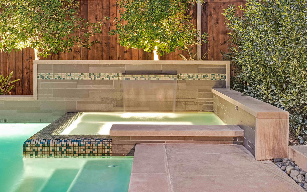 sunnyland-modern-pool-spa-fountain-night.jpg