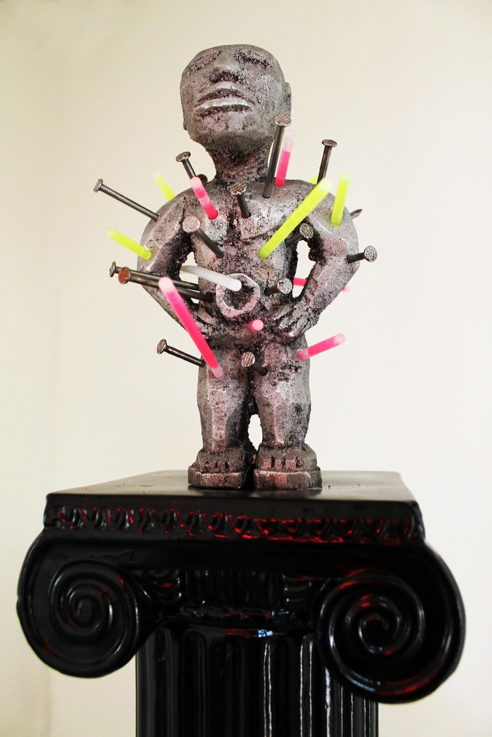 Matthew Couper   Contemporary Devotional Nsiki  2014  Cast aluminium, ceramic plinth, steel nails, glow sticks  62 x 18 x 18cm   AUD $6,600