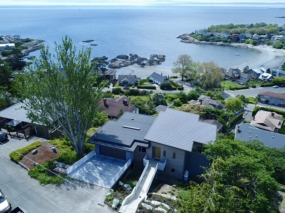 Aerial View of Rebuilt Modern House design and rebuild on steep lot on Gonzales Hill in Victoria BC by MDRN Built