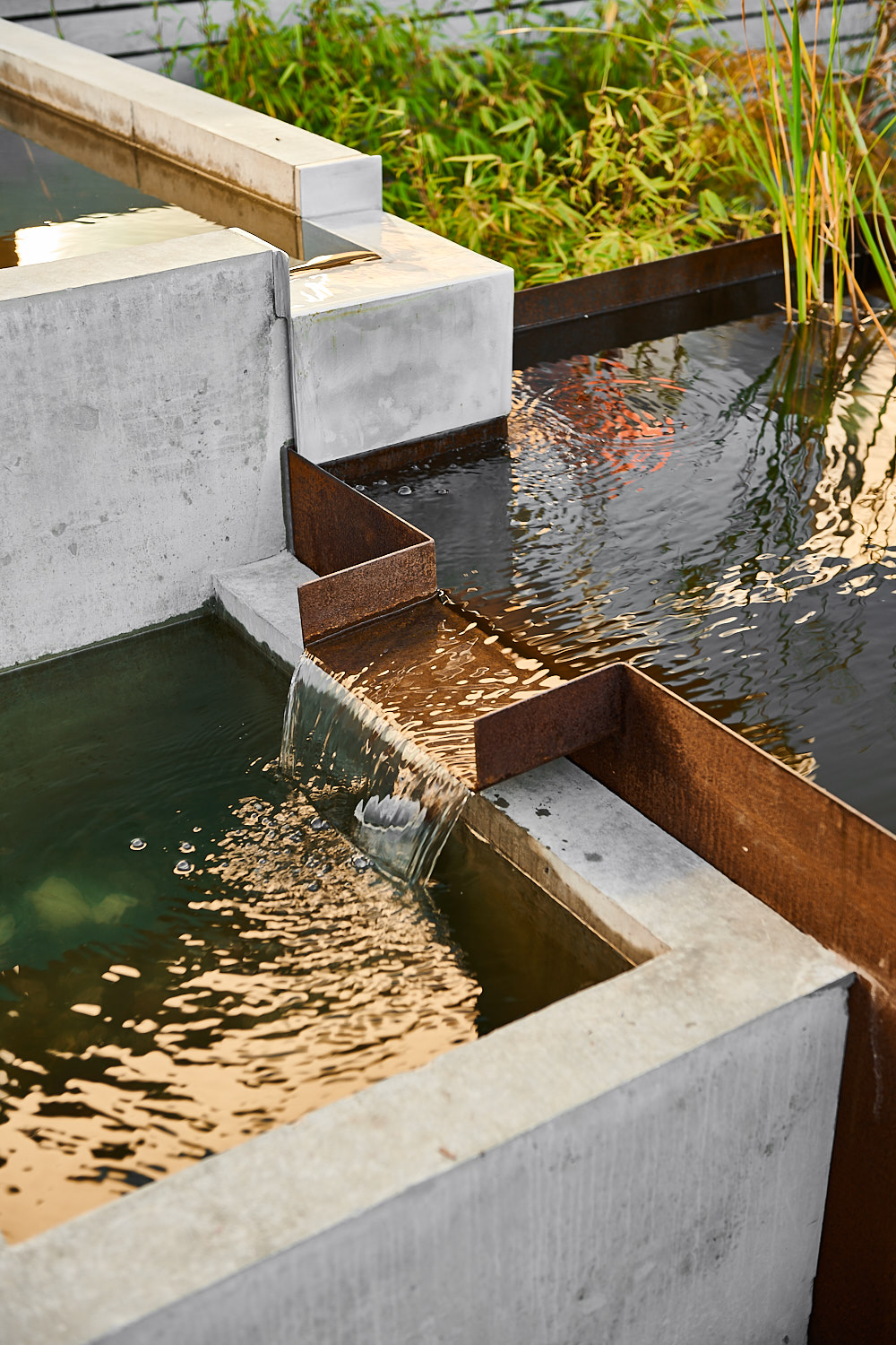 Modern Water feature from Corten steel and cast in place architectural concrete.
