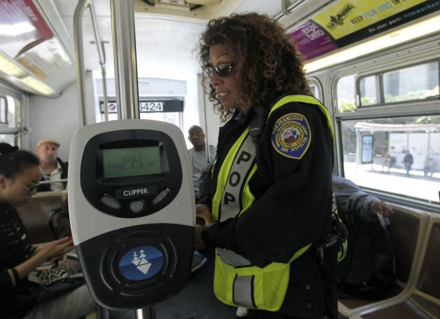 Fare validators like this one at the rear of a San Francisco MUNI bus would need to be installed to truly facilitate proper fare collection at all doors on the Green Line.