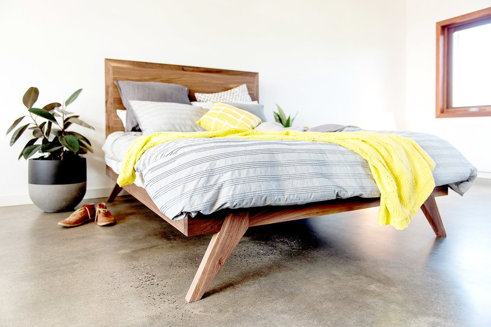 Designer walnut bed